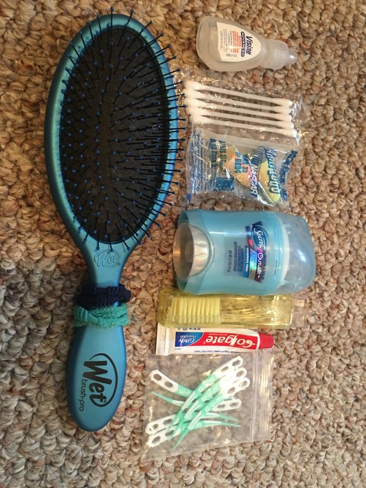 I tie extra hair ties around the bottom of my brush.